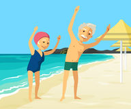 Mature people doing physical exercise on the beach Royalty Free Stock Image