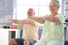 Mature people exercising happily. In the gym Stock Image