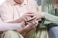 Mature people holding hands Stock Images