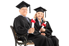 Mature people posing with diplomas Royalty Free Stock Images