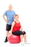 Mature people in sportswear posing Stock Photo