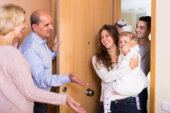 Mature people welcoming dear guests Royalty Free Stock Images