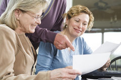 Mature people working on paperwork Stock Image