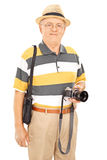 Mature photographer holding camera and Royalty Free Stock Photos
