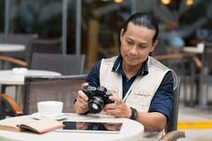 Mature photographer Stock Images