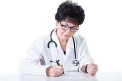 Mature physician Stock Images