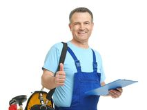 Mature plumber with clipboard and tool bag. On white background royalty free stock photo
