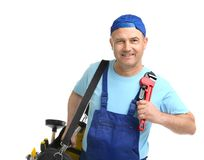 Mature plumber with pipe wrench and tool bag. On white background stock images