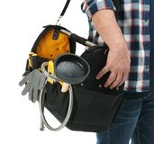 Mature plumber with tool bag. On white background, closeup royalty free stock photos