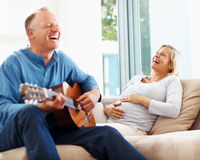 Mature pregnant couple enjoying themselves Stock Photo