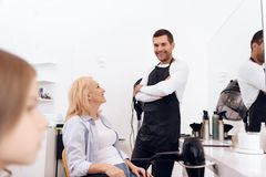 Mature pretty woman is doing hairdo in beauty salon. Female stylish haircut. Mature pretty women is doing hairdo in beauty salon. Female stylish haircut. Young stock images