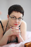Mature pretty woman in glasses posing for the camera. Royalty Free Stock Photos