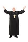 Mature priest with his hands in the air Royalty Free Stock Photos