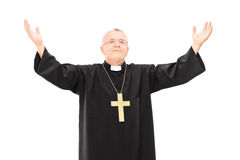 Mature priest with his hands in the air Stock Image