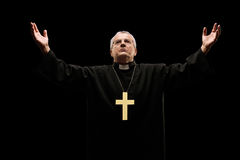 Mature priest praying to god Stock Photo