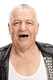 Mature punk rocker with a few broken teeth. Vertical shot of a cheerful mature punk rocker with a few broken teeth isolated on white background Royalty Free Stock Photo