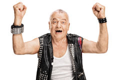 Mature punk rocker gesturing happiness. Studio shot of a delighted mature punk rocker gesturing happiness with his hands isolated on white background Royalty Free Stock Image