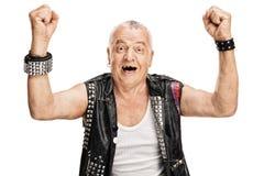 Mature punk rocker gesturing happiness Royalty Free Stock Image