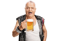 Mature punk rocker holding a pint of beer. Crazy mature punk rocker holding a pint of beer and looking at the camera isolated on white background Stock Photo