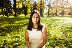 Mature real brunette woman in green spring park, lifestyle conce Royalty Free Stock Images