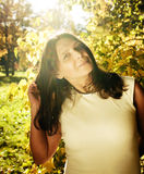Mature real brunette woman in green spring park, lifestyle conce Royalty Free Stock Photos