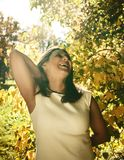 Mature real brunette woman in green spring park, lifestyle conce. Pt outside sunlight everywere stock images