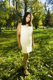 Mature real brunette woman in green spring park, lifestyle conce. Pt outside sunlight everywere royalty free stock image