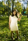 Mature real brunette woman in green spring park, lifestyle conce stock images