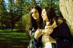 Mature real mother with daughter outside autumn fall in park. Recreation concept stock photography