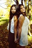 Mature real mother with daughter outside autumn fall in park. Recreation concept stock photo
