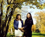 Mature real mother with daughter outside autumn fall in park. Recreation concept royalty free stock photo