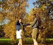 Mature real mother with daughter outside autumn fall in park. Recreation concept royalty free stock photography