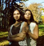 Mature real mother with daughter outside autumn fall in park stock photo