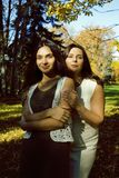 Mature real mother with daughter outside autumn fall in park. Recreation concept royalty free stock image