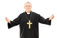 Mature reverend in black mantle with open hands. Isolated on white background Stock Image