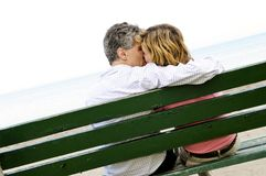 Mature romantic couple on a bench Royalty Free Stock Image