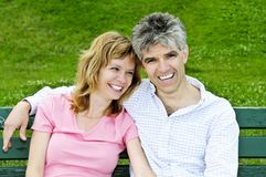 Mature romantic couple on a bench Stock Photography