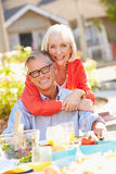 Mature Romantic Couple Enjoying Outdoor Meal In Garden Royalty Free Stock Photography