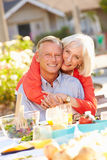 Mature Romantic Couple Enjoying Outdoor Meal In Garden Royalty Free Stock Photos