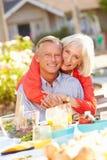 Mature Romantic Couple Enjoying Outdoor Meal In Garden Royalty Free Stock Photos