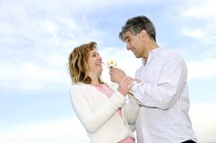 Mature romantic couple with flowers stock photo