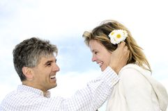 Mature romantic couple with flowers Stock Photography