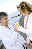 Mature romantic couple with flowers Royalty Free Stock Photo