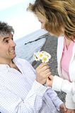 Mature romantic couple with flowers Royalty Free Stock Photography