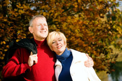 Mature romantic couple in a park Royalty Free Stock Image