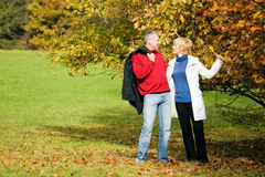 Mature romantic couple in a park Stock Image