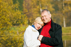 Mature romantic couple in a park Stock Photos