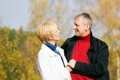 Mature romantic couple in a park Stock Images