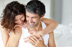 Mature romantic couple relaxing on each other Stock Image