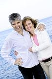 Mature romantic couple at seashore Stock Image
